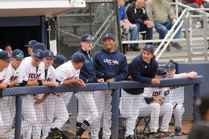 The UConn baseball team is all smiles in the dugout in a game last year at J.O. Christian Field. (File photo/The Daily Campus)