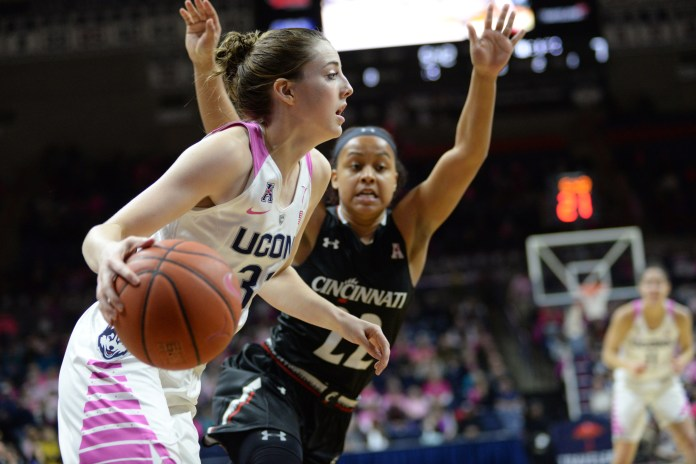 Katie Lou Samuelson dribbles baseline in the 88-34 victory against Cincinatti on Feb. 17, 2016. (Ashley Maher/Daily Campus)