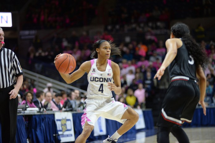 Moriah Jefferson looks for a pass in the 88-34 victory against Cincinatti on Feb. 17, 2016. (Ashley Maher/Daily Campus)