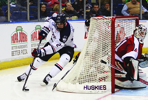 Max Letunov attacks the net during UConn's 5-2 loss to Northeastern at the XL Center on Friday Feb. 19, 2016. (Tyler Benton/The Daily Campus)