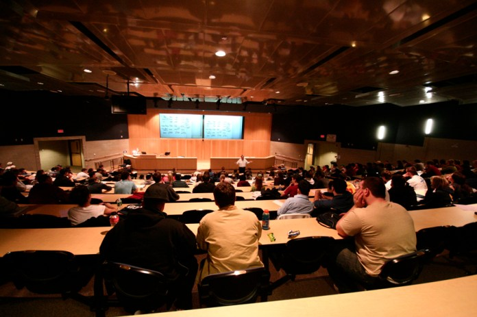 Students sit in a lecture hall. UConn is currently conducting an assessment of the school's General Education requirements. (File Photo)