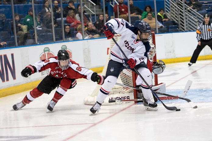 UConn men's ice hockey forward Maxim Letunov handles the puck in front of the Northeastern net during the Huskies' game at the XL Center in Storrs, Connecticut on Friday, Feb. 19, 2016. (Tyler Benton/The Daily Campus)