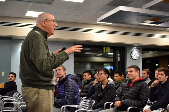 Rich Dino gives the second installment of a series of Innovation Quest Workshops and discusses the process of applying to the iQ competition in the UConn School of Business Lounge. (Olivia Stenger/The Daily Campus)