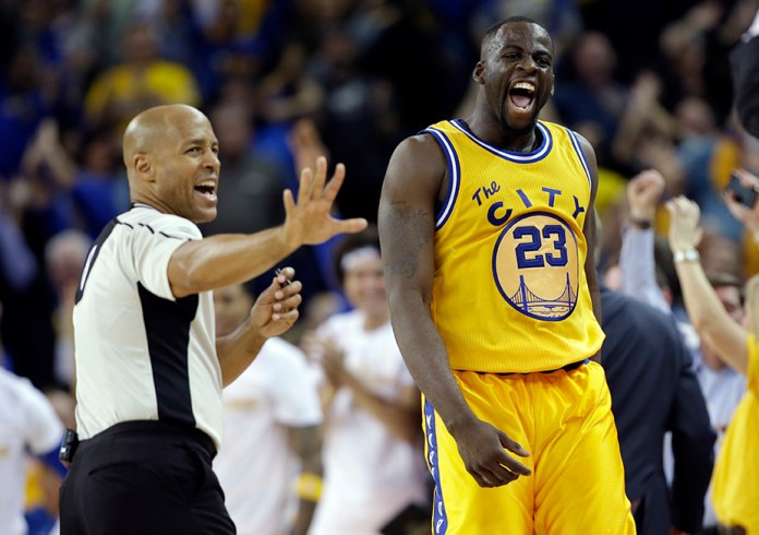 Golden State Warriors' Draymond Green reacts after scoring against the Atlanta Hawks during overtime of an NBA basketball game Tuesday, March 1, 2016, in Oakland, Calif.Golden State won 109-105 in overtime. (AP Photo/Marcio Jose Sanchez)