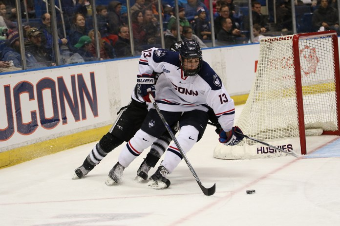 Joseph Masonious takes the puck around the net during UConn's 5-2 loss against Providence College at the XL Center on Friday Feb. 19, 2016. Masonious, a freshman defender, has 20 points on the season. (Tyler Benton/The Daily Campus)