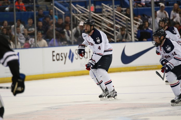 Kyle Huson patrols the goal line during UConn's 5-2 loss to Northeastern on Fe. 16, 2016 at the XL Center. Huson, a senior defenseman, has taken the younger players on the team under his wing. (Tyler Benton/The Daily Campus)