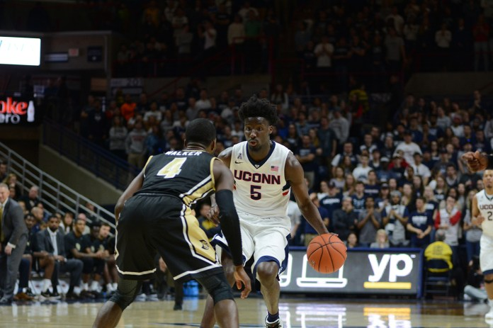 Forward Daniel Hamilton looks to attack the basket during UConn's 67-46 victory over UCF at Gampel Pavilion on Sunday March 6, 2016. Hamilton led the Huskies in scoring with 12 points. (Matthew Zabierek/The Daily Campus)