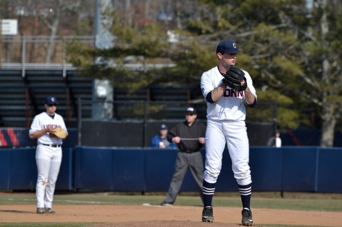 Andrew Zapata leans in for a sign while pitching against Yale during UConn's 8-2 victory at J.O. Christian Field on Tuesday March 8, 2016. Zapata pitched six scoreless innings. (Rebecca Newman/The Daily Campus)