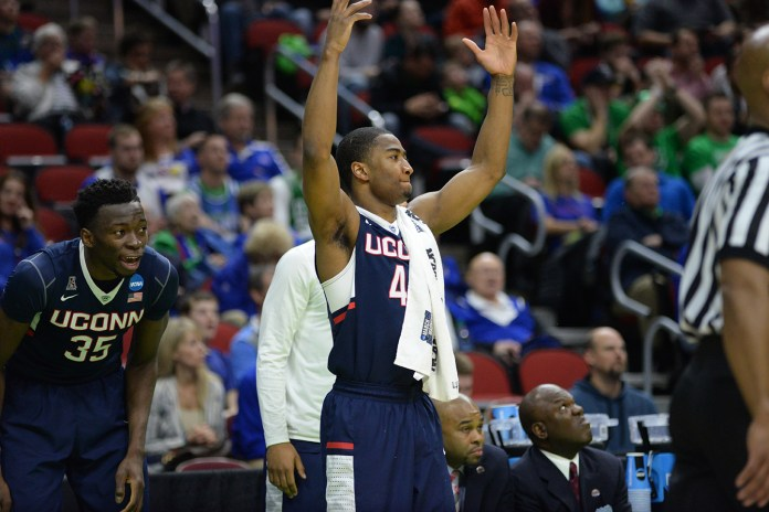 Amida Brimah (left) and Rodney Purvis (right) celebrate UConn's 74-67 victory over Colorado in the first round of the NCAA tournament. Both players will return to a deep, talented squad next year. (Ashley Maher/The Daily Campus)