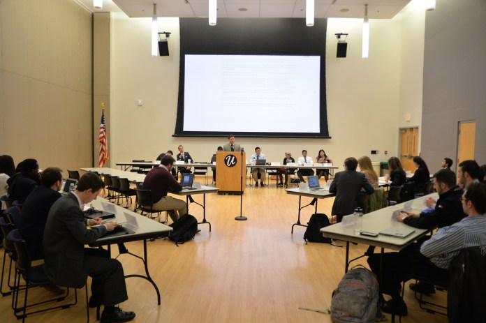 CLAS Senator Bennett Cognato speaks at a meeting of the Undergraduate Student Government Senate on Wednesday, March 30. A statement of position opposing ScHOLA2RS House was nearly unanimously supported with one dissenting vote in the Senate. (Amar Batra/The Daily Campus)
