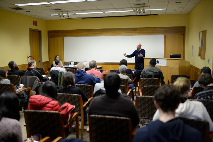 """Professor Christian Appy of UMass Amherst gives a lecture on """"why the Vietnam war still matters."""" in 1974 Conference Room on April 6, 2016. (Jason Jiang/The Daily Campus)"""