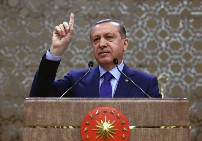 Turkish President Recep Tayyip Erdogan addresses a meeting of local administrators in Ankara, Turkey, Wednesday, April 6, 2016.(Yasin Bulbul/Presidential Press Service, Pool via AP)