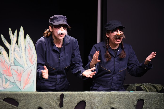 """Marta Mozelle MacRostie and Liz Hara perform during the Ballard Institute and Museum of Puppetry's showing of """"Help Save the Monkey!"""" in Storrs, Connecticut on Saturday, April 9, 2016. (Allen Lang/The Daily Campus)"""