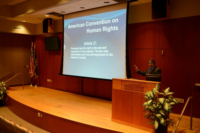 """Professor James Anaya from the College of Law at the University of Arizona speaks during his lecture """"A Human Rights Advocate's Guide to the United Nations Sustainable Developmental Goals (SDGs)"""" in the Dodd Center's Konover Auditorium in Storrs, Connecticut on Friday, April 8, 2016. (Jason Jiang/The Daily Campus)"""