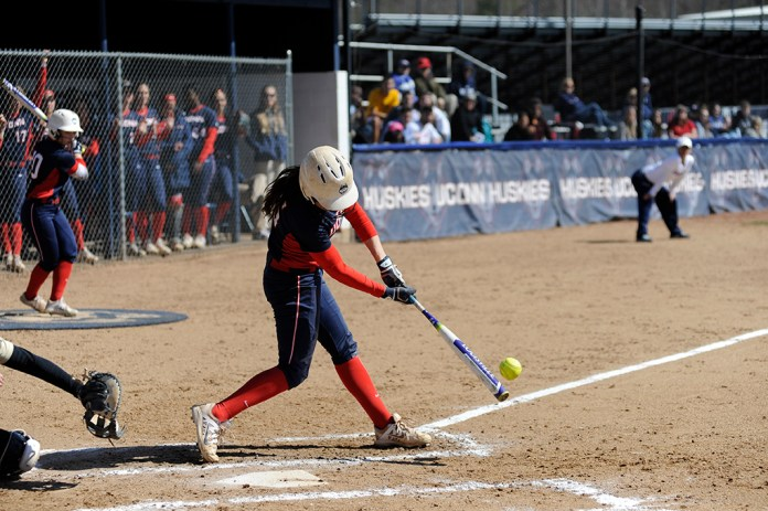 Junior Taylor Townsend makes contact during one of UConn's victories over Bryant on March 30, 2016 at Burrill Family Field. Townsend is hitting .243 in 36 starts this year. (Jason Jiang/The Daily Campus)