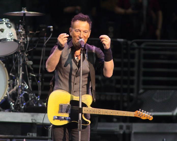"""In this Feb. 12, 2016 file photo, Bruce Springsteen performs in concert with the E Street Band during their """"The River Tour 2016"""" at the Wells Fargo Center in Philadelphia. Springsteen has canceled his concert in North Carolina, citing the state's new law blocking anti-discrimination rules covering the LGBT community. In a statement on his website Friday, April 8, 2016, Springsteen said he was canceling the concert scheduled for Sunday in Greensboro because of the law, which critics say discriminates against gay, lesbian, bisexual and transgender people. (Photo by Owen Sweeney/Invision/AP, File)"""