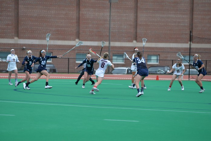 Kelsey Catalano attacks the net during UConn's 13-8 victory over Villanova at the Sherman Family Sportsplex on March 26, 2016. (Amar Batra/The Daily Campus)