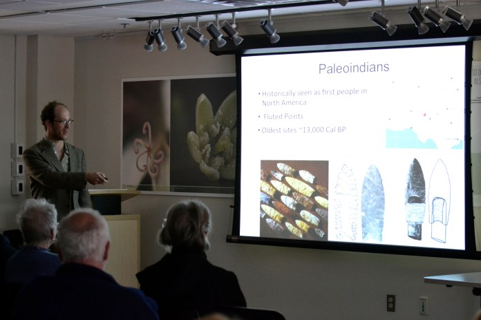 Doctoral candidate Zachary Singer speaks during a lecture about his research into the Paleoindian period on Sunday, April 17, 2016 in Storrs, Connecticut. (Rebecca Newman/The Daily Campus)