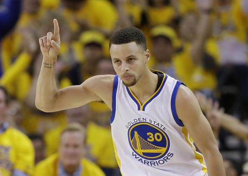 G olden State Warriors' Stephen Curry celebrates after scoring against the Houston Rockets during the first half in Game 1 of a first-round NBA basketball playoff series Saturday, April 16, 2016, in Oakland, Calif. (AP Photo/Marcio Jose Sanchez)