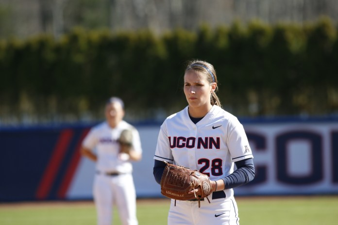 Kayla Doty sets herself to pitch during a game on Friday, April 15 at Burrill Family Field. The Huskies took two games out of three against conference rival East Carolina University over the weekend. (Tyler Benton/The Daily Campus)