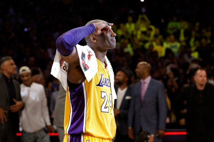 Los Angeles Lakers'Kobe Bryant solutes as he acknowledges fans after the last NBA basketball game of his career, against the Utah Jazz on Wednesday, April 13, 2016, in Los Angeles.Bryant scored 60 points as the Lakers won 101-96. (AP Photo/Jae C. Hong)