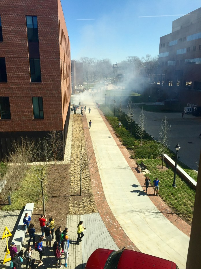 Smoke from the brush fire outside of Oak Hall was seen from the third floor of the building on Wednesday, April 20, 2016. (Cheyenne Haslett/Daily Campus)