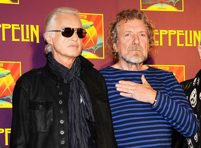"""In this Oct. 9, 2012 file photo, members of Led Zeppelin, guitarist Jimmy Page, left, and singer Robert Plant appear at a press conference ahead of the worldwide theatrical release of """"Celebration Day"""", a concert film of their 2007 London O2 arena reunion show, in New York.(Photo by Evan Agostini/Invision/AP, File)"""