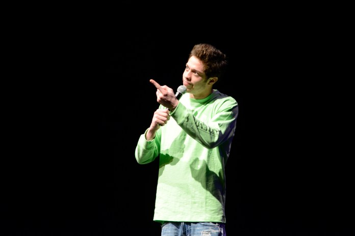 """Comedian Pete Davidson, a regular cast member on """"Saturday Night Live,"""" performs during a Spring Weekend comedy show in the Jorgensen Center for the Performing Arts in Storrs, Connecticut on Friday, April 22, 2016. (Jason Jiang/The Daily Campus)"""