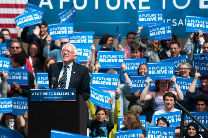 Democratic presidential candidate Bernie Sanders smiles to supporters as he takes the stage at a rally along the Connecticut River in Hartford on Monday, April 25, 2016. (Kyle Constable/Daily Campus)