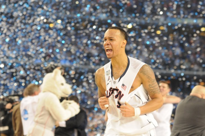 Shabazz Napier grabs his jersey in celebration after winning the 2014 NCAA men's basketball National Championship game, 60-54, against the University of Kentucky on April 7, 2014 at AT&T Stadium in Arlington, Texas. He was the tournament MVP and helped lead the Huskies on a storied title run.(File photo/The Daily Campus)