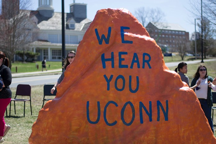 """During an event at the Spirit Rock in April 2015, students gathered in response to a """"Black Lives Matter"""" message on the rock being defaced. The word """"Black"""" was painted over. The above message signaled inclusion on the UConn campus. (Rebecca Newman/The Daily Campus)"""
