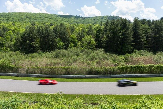 """A view of the back straightaway, nicknamed the """"No Name Straight"""" as the GT cars race by.(Jackson Haigis/Daily Campus)"""