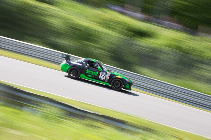 Daniel Moen's Mazda MX-5 Cup rockets down the downhill section of the track. The event ran from 9 am to 6 pm, providing fans with hours of live racing and an authentic racing environment.(Jackson Haigis/Daily Campus)
