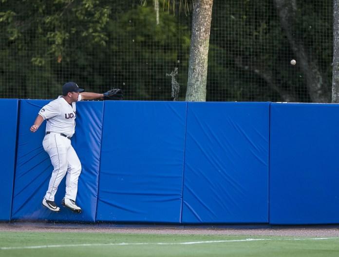 Connecticut's Joe DeRoche-Duffin cannot snag Florida's Danny Reyes's home run during an NCAA college regional baseball game Saturday, June 4, 2016, in Gainesville, Fla. (Cyndi Chambers/The Gainesville Sun via AP)