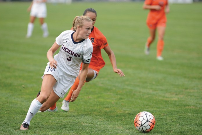 UConn junior forward Rachel Hill dribbles away from a Syracuse defender during the Huskies' game at Joseph J. Morrone Stadium in Storrs, Connecticut on Sept. 3. 2015. (Jason Jiang/The Daily Campus)