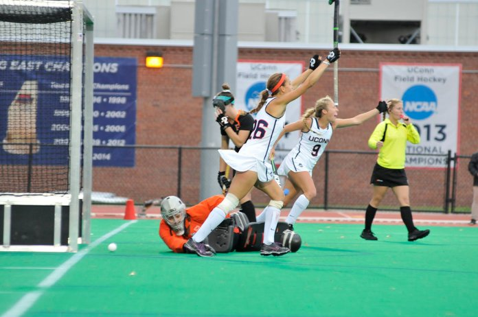 Charlotte Veitner (26) and Amelia Iacobucci (9) celebrate a goal during UConn's 4-1 victory over Princeton on Sunday, Oct. 25, 2015. The Huskies improved to 17-0 on the season with the victory. Veitner set the UConn single season record for points with 99 as a sophomore.(Jason Jiang/The Daily Campus)