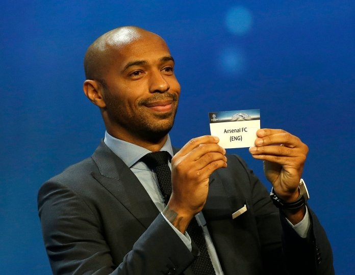 Former player Thierry Henry shows the name of Arsenal FC, who will play in Group A, during the UEFA Champions League draw at the Grimaldi Forum, in Monaco, Thursday, Aug. 25, 2016. (Claude Paris/AP)