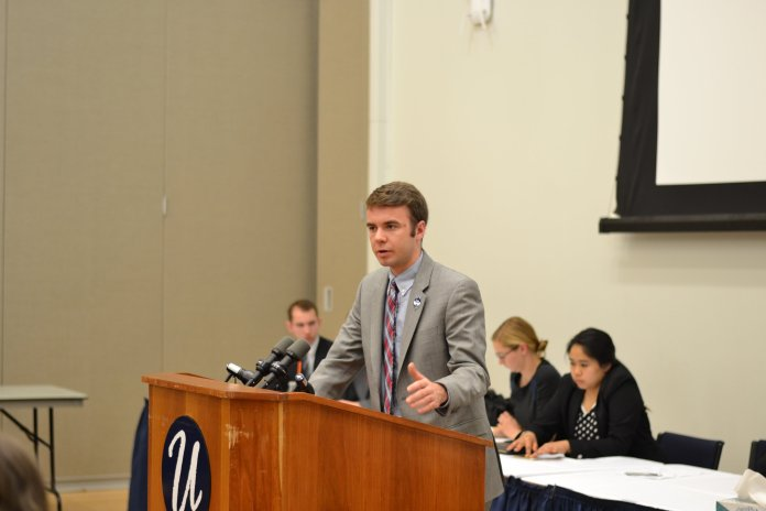 In this file photo, Adam Kuegler speaks at an Undergraduate Student Government senate meeting on April 29, 2015. Kuegler is the new student representative on the UConn Board of Trustees. (File/The Daily Campus)