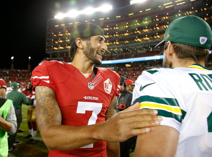 San Francisco 49ers quarterback  Colin  Kaepernick , left, greets Green Bay Packers quarterback Aaron Rodgers at the end of an NFL preseason football game Friday, Aug. 26, 2016, in Santa Clara, Calif. Green Bay won 21-10. (Tony Avelar/AP)