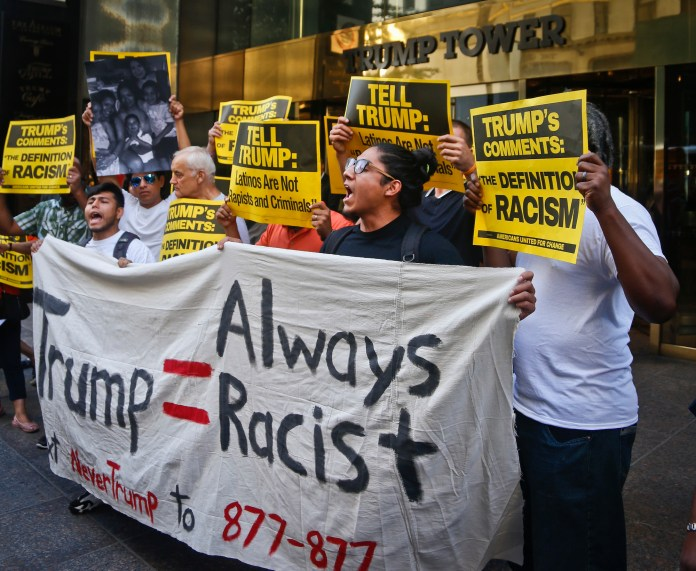 Anti-Trump protesters, including fifth-semester student Eric Cruz Lopez,demonstrate outside a meeting between Donald Trump and minority Republicans at TrumpTower, Thursday Aug. 25, 2016, in New York. (Bebeto Matthews/AP)
