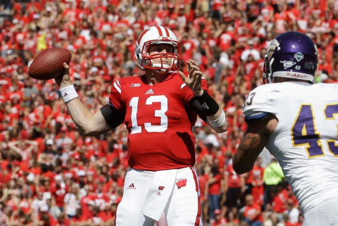 In this Sept. 6, 2014, file photo, Wisconsin quarterback  Bart  Houston throws during the second half of an NCAA college football game against Western Illinois in Madison, Wis  . (AP Photo/Morry Gash, File)