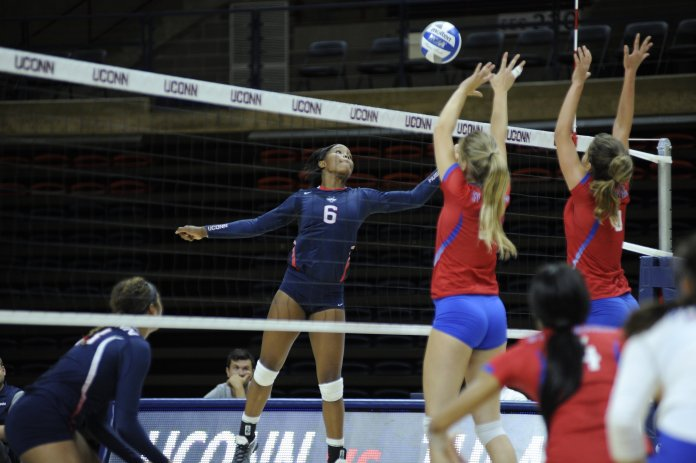 Kayla Williams rises for a spike during UConn's 3-0 victory over St. Francis-Brooklyn at Gampel Pavilion on Saturday Sept. 10, 2016. (Jason Jiang/The Daily Campus)