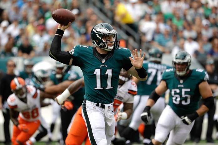 Philadelphia Eagles quarterback Carson Wentz passes during the first half of an NFL football game against the Cleveland Browns, Sunday, Sept. 11, 2016, in Philadelphia. (Matt Rourke/AP)