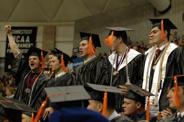 Students rise at the University of Connecticut commencement ceremony in 2006. (File Photo/The Daily Campus)