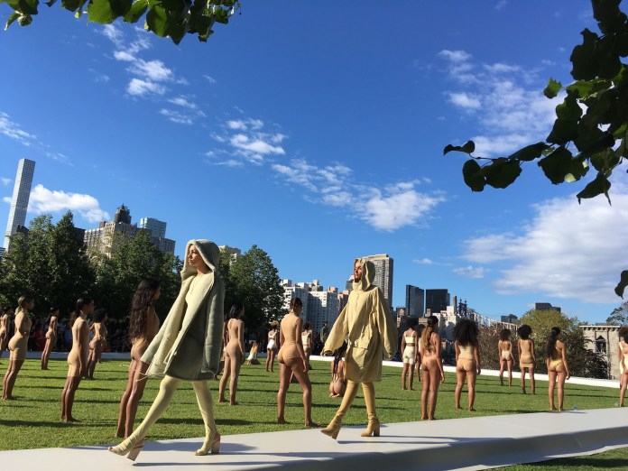 Models wear the Yeezy Season 4 collection by  Kanye West during a fashion show, Wednesday, Sept. 7, 2016, at the Franklin D. Roosevelt Four Freedoms Park on Roosevelt Island in New York. The show, set to an eery soundtrack, helped kick off New York Fashion Week. (AP Photo/Leanne Italie)