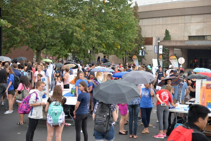 Over 7,000 tudents braved the rain and gathered on Fairfield Way on Wednesday afternoon for the Involvement Fair. (Amar Batra/The Daily Campus)