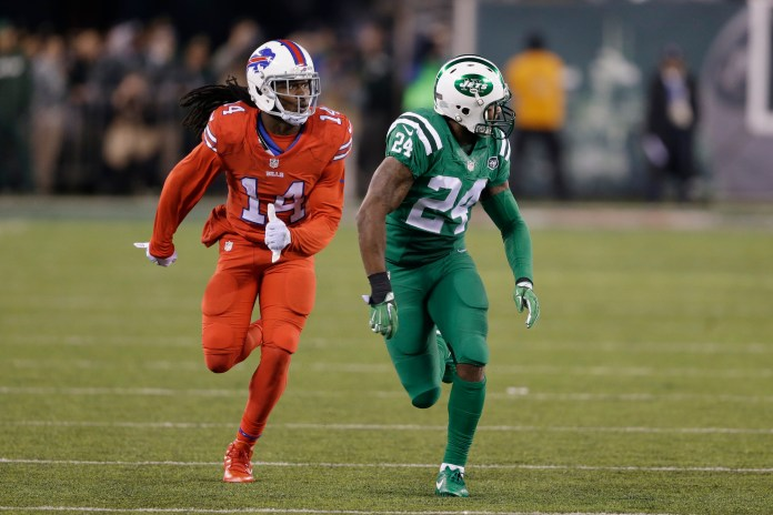 """In this Nov. 12, 2015, file photo, Buffalo Bills wide receiver Sammy Watkins, left, is defended by New York Jets cornerback Darrelle Revis during the first half of an NFL football game, in East Rutherford, N.J. The NFL isn't colorblind to the concerns of its TV audience regarding the """"Color Rush"""" alternate uniforms the Bills and Jets will wear Thursday night, Sept. 14, 2016. That's a switch from last year, when Buffalo wore all red and the Jets all green during their prime-time game on Nov. 12. The combinations led to colorblind viewers complaining they couldn't determine which team was which. (Seth Wenig/AP)"""