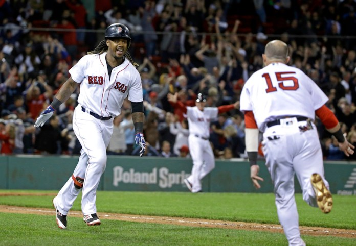 Boston Red Sox's Hanley Ramirez celebrates with teammates at the plate after hitting a three-run walk-off homer in a baseball game against the New York Yankees at Fenway Park, Thursday, Sept. 15, 2016, in Boston. The Red Sox won 7-5. (Elise Amendola/AP)