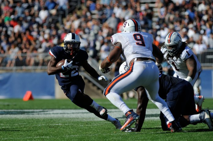 Running back Arkeel Newsome jukes past the Virginia defense during a 13-10 victory on Saturday, Sept. 17 at Pratt and Whitney Stadium in East Hartford. Newsome finished the game with a season-high 77 yards on 13 carries. (Photo by Jason Jiang/The Daily Campus)