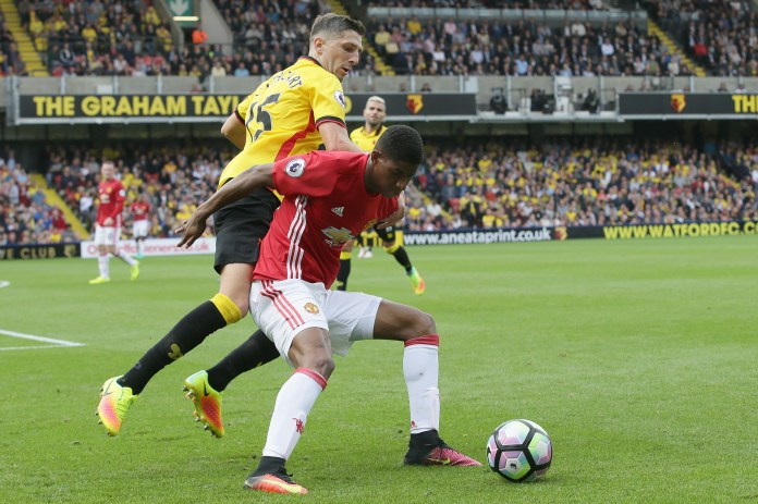 Manchester United's Marcus Rashford, right, protects the ball from Watford's Craig Cathcart during the English Premier League soccer match between Watford and Manchester United at Vicarage Road in London, Sunday Sept. 18, 2016. (AP Photo/Tim Ireland)
